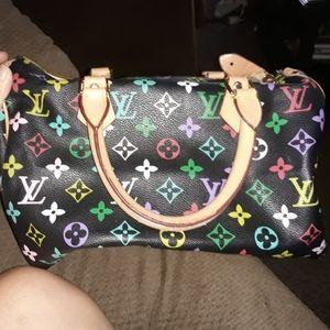 Louis Vuitton purse women's serial#M41526.